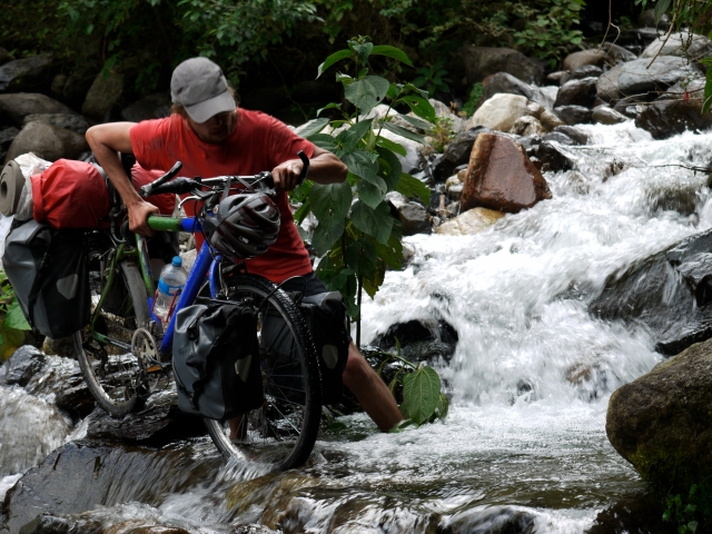 Ronal crossing a river in Bolivia.